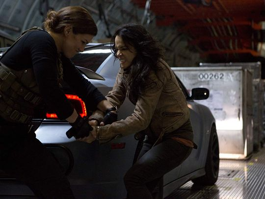 Michelle Rodriguez and Gina Carano in Furious 6 (2013)-1579443010316