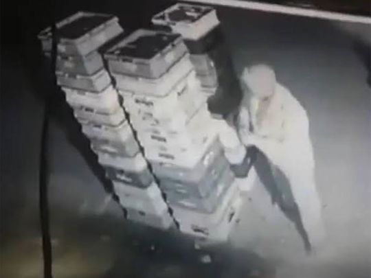 A Noida policeman caught on camera stealing milk