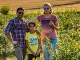 Ajay, Ramona and Oliver at their blueberry farm
