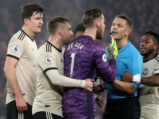 An angry David de Gea shouts at the referee during the match between Liverpool and Manchester United.