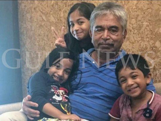 Nair's three children Sreebhadra, 9 years, Aarcha, 8 years and Abhinav, 7 years with their grandfather (Saranya's father).