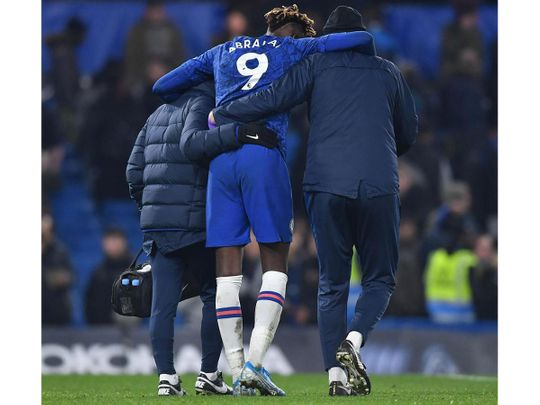Tammy Abraham goes off injured during Chelsea's match with Arsenal.