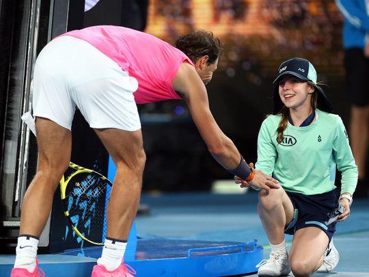 Nadal gives his head band to the ballgirl