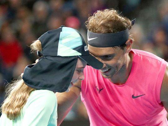 Rafael Nadal speaks with a ballgirl