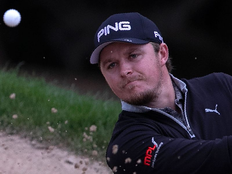 England's Eddie Pepperell plays a bunker shot on the 10th hole during the second round of the Dubai Desert Classic.