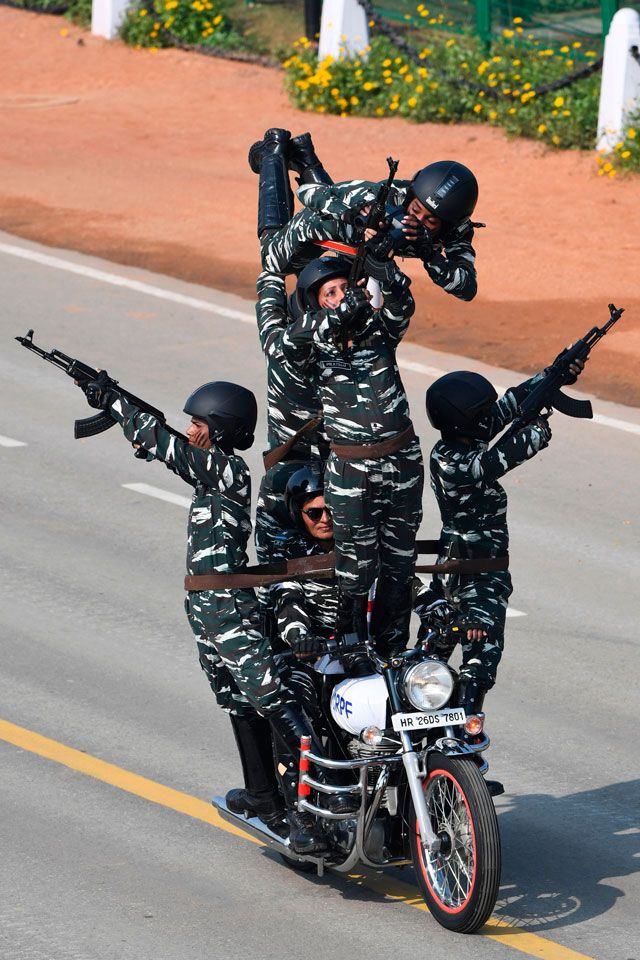 Central Reserve Police Force (CRPF) women motorcycle team members perform during the Republic Day parade in New Delhi on January 26, 2020.