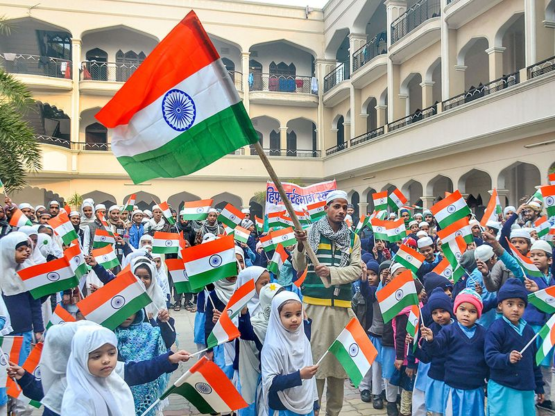 Students celebrate 71st Republic Day at Jamia Qasmia Madrasa Shahi in Moradabad, Sunday, Jan. 26, 2020.