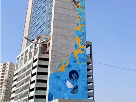 The mural is titled 'Rising Blue'.
