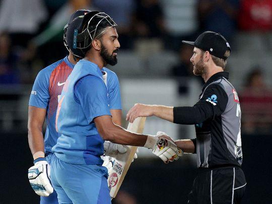 India's Lokesh Rahul (L) speaks to New Zealand's captain Kane Williamson