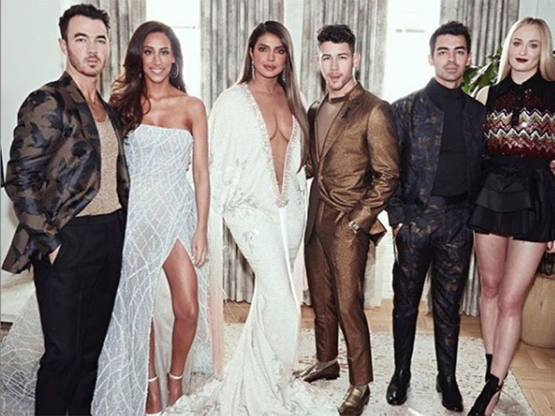 Jonas Brothers and their spouses.
