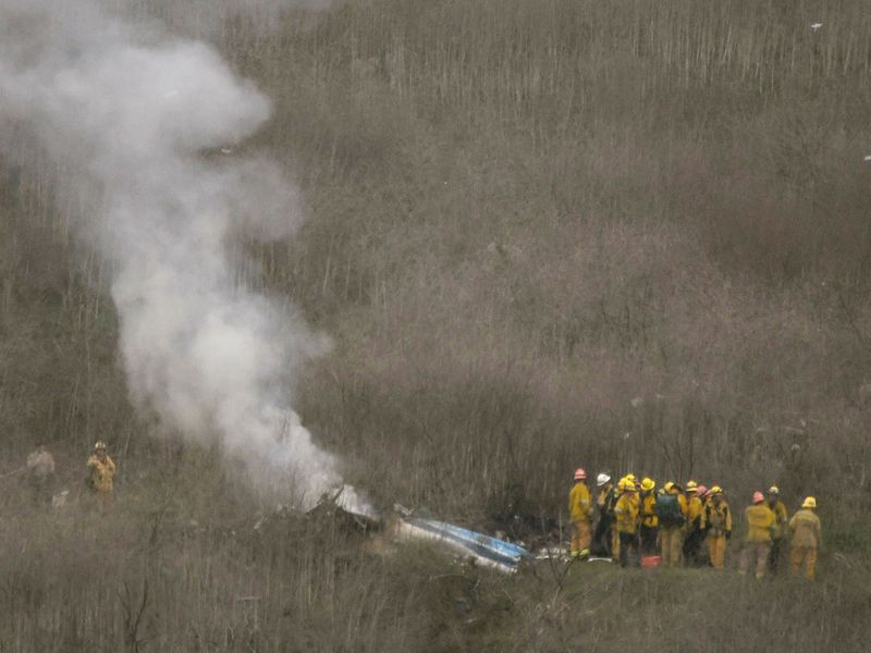LA county firefighters on the scene of a helicopter crash that reportedly killed Kobe Bryant in Calabasas on Sunday.