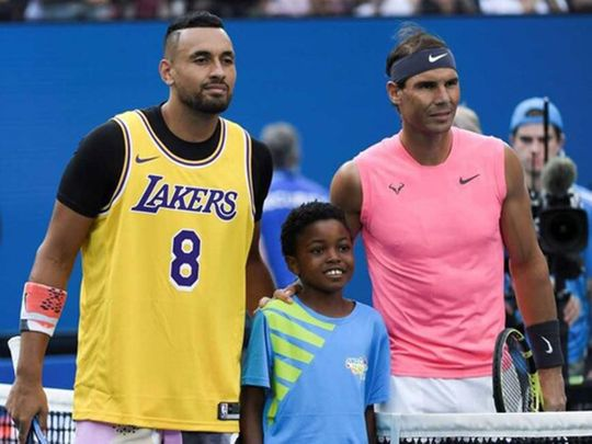 Nick Kyrgios in a Lakers top before his match with Rafael Nadal.