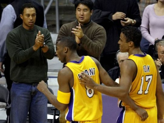 Tiger Woods cheers on Kobe Bryant during a LA Lakers game.