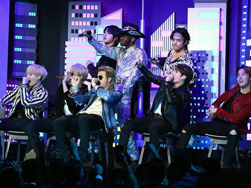 US rapper Lil Nas X (C) and South Korean boy band BTS