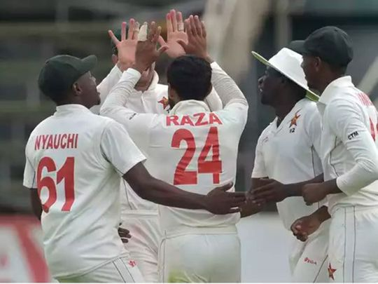 Zimbabwe celebrate the dismissal Karunaratne