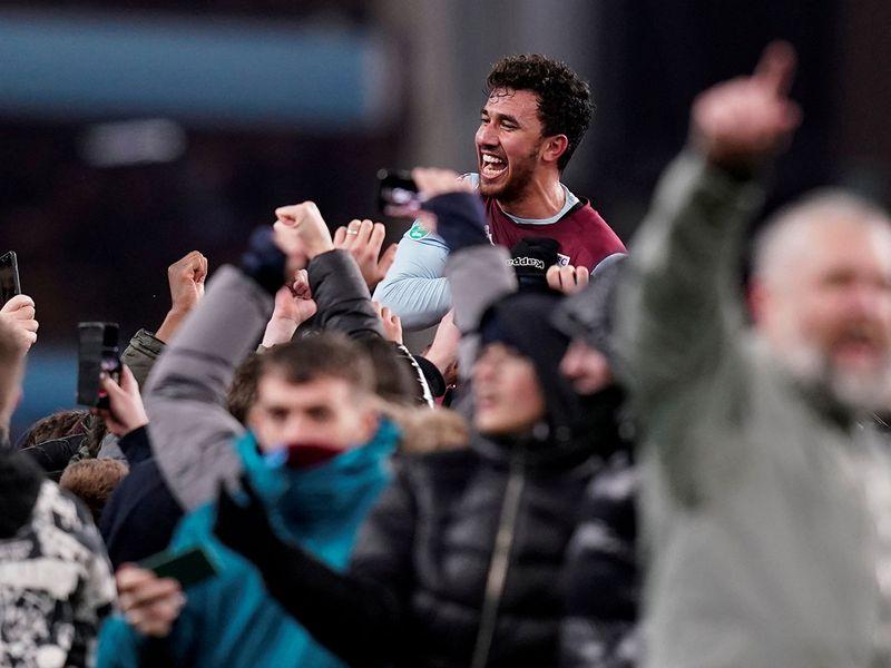 Aston Villa's Trezeguet celebrates after the match with the fans.