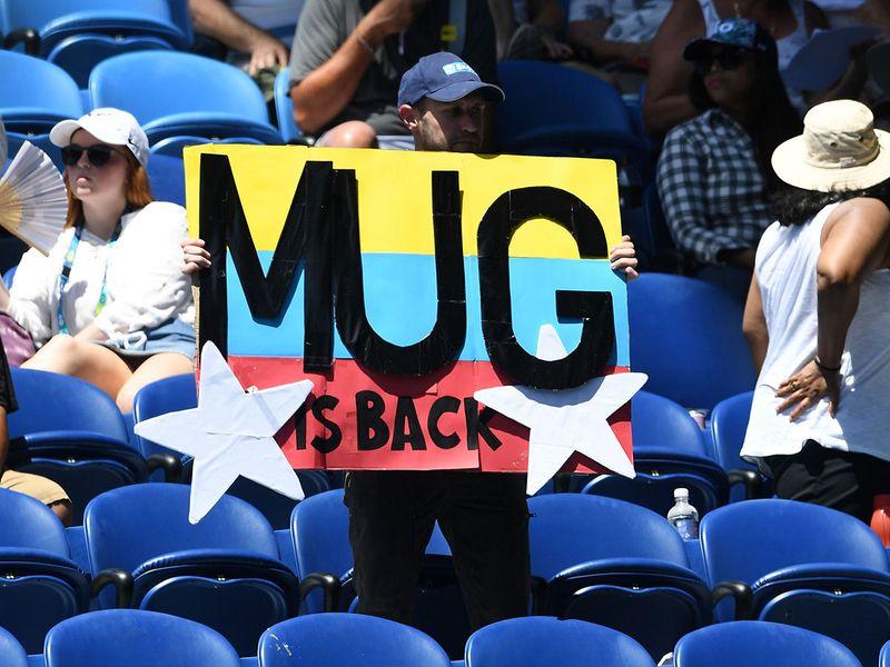 A supporter of Spain's Garbine Muguruza cheers her on against Russia's Anastasia Pavlyuchenko.