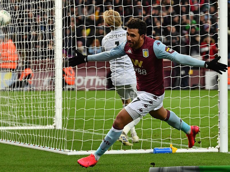 Aston Villa's Egyptian midfielder Trezeguet celebrates scoring his team's second goa