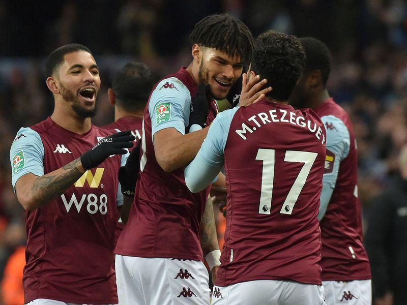 Aston Villa's Trezeguet is congratulated by Tyrone Mings and Douglas Luiz.