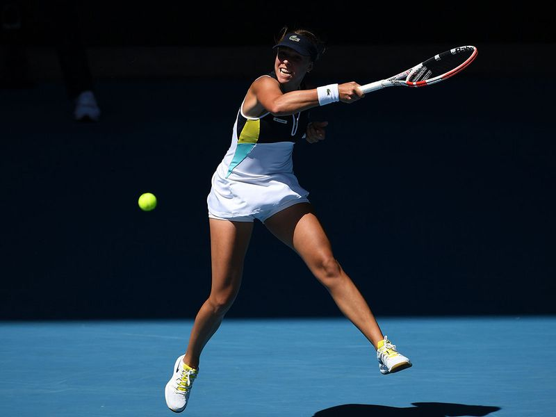 Estonia's Anett Kontaveit hits a return against Romania's Simona Halep.
