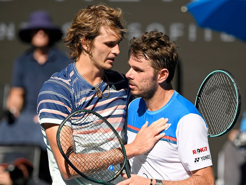 Germany's Alexander Zverev, left, is congratulated by Switzerland's Stan Wawrinka after winning their quarter-final match at the Australian Open.
