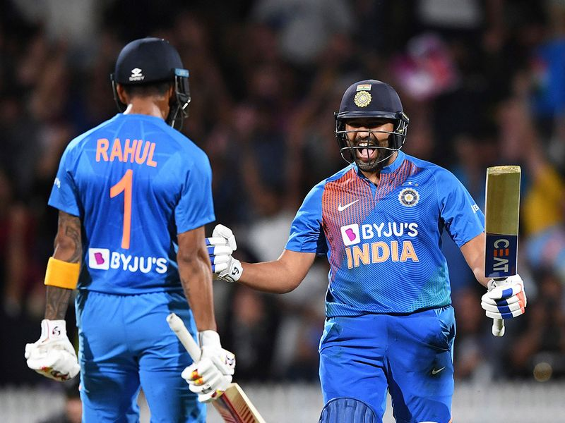 India's Rohit Sharma celebrates with KL Rahul, left, after hitting the winning runs in the super over.