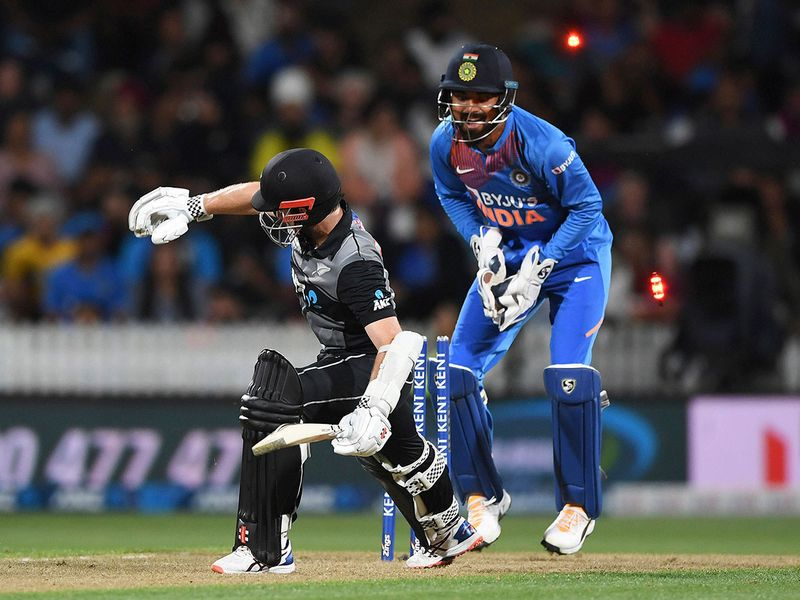 Kane Williamson loses his balance as India wicketkeeper KL Rahul attempts a stumping.