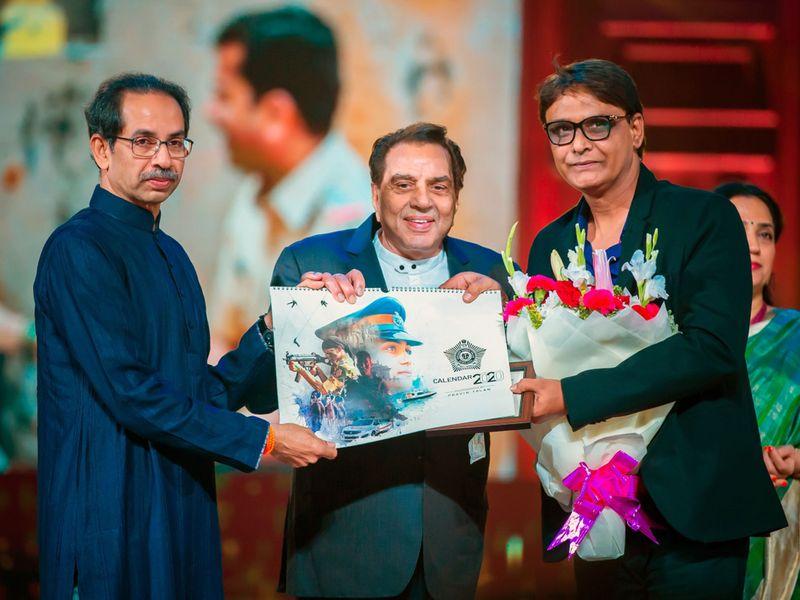 Maharashtra Chief Minister Uddhav Thackeray, veteran actor Dharmendra and photographer Pravin Talan