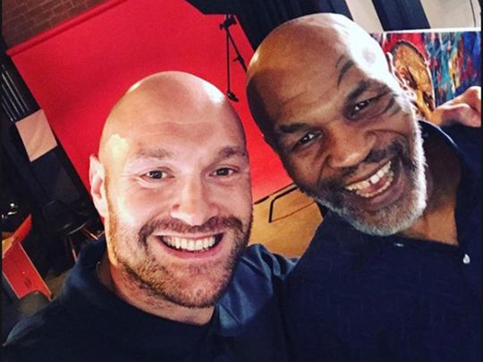 Tyson Fury and Mike Tyson.