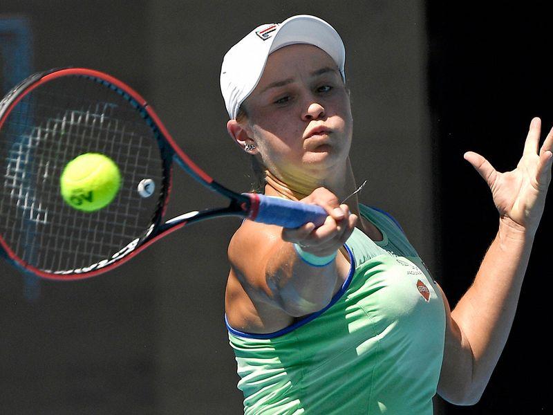 Australia's Ashleigh Barty makes a forehand return to Sofia Kenin