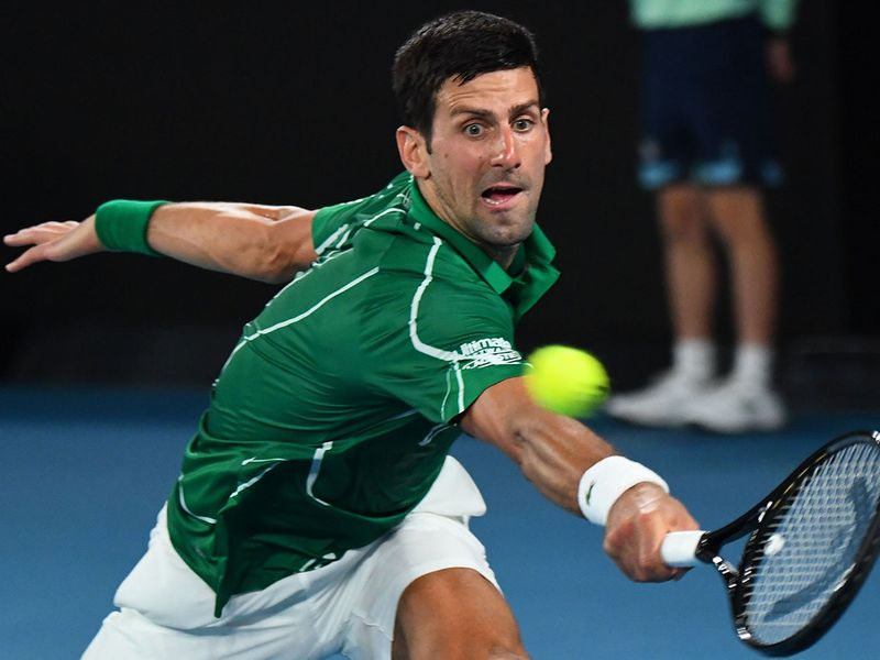 Novak Djokovic hits a return against Roger Federer during their men's singles semi-final match