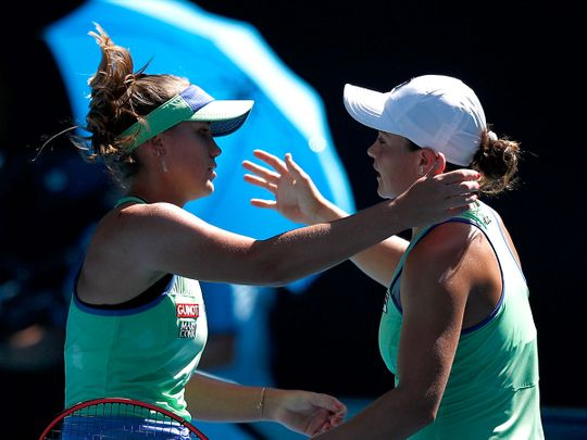 Sofia Kenin of the U.S. and Australia's Ashleigh Barty embrace after their match.