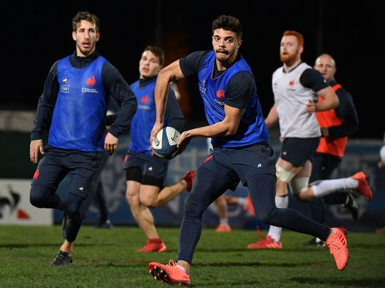 France's fly-half Romain Ntamack practices during a training session