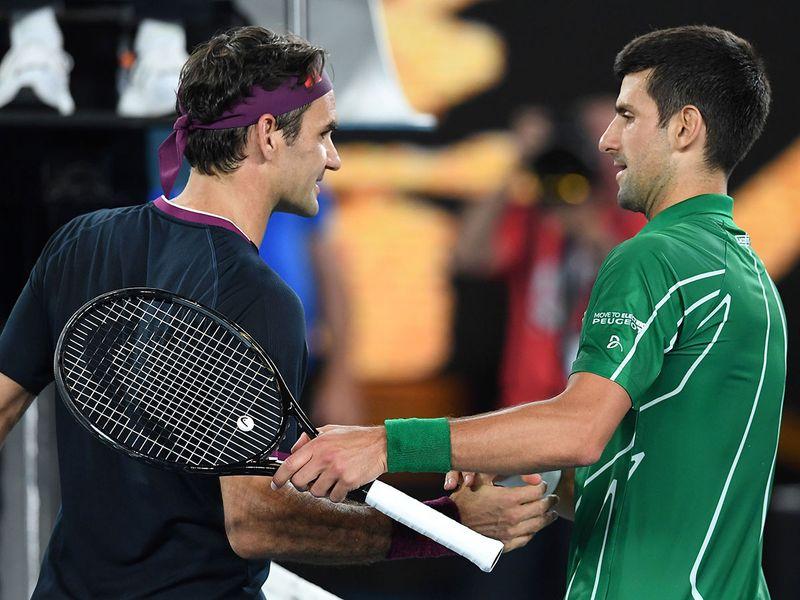 Roger Federer congratulates Novak Djokovic