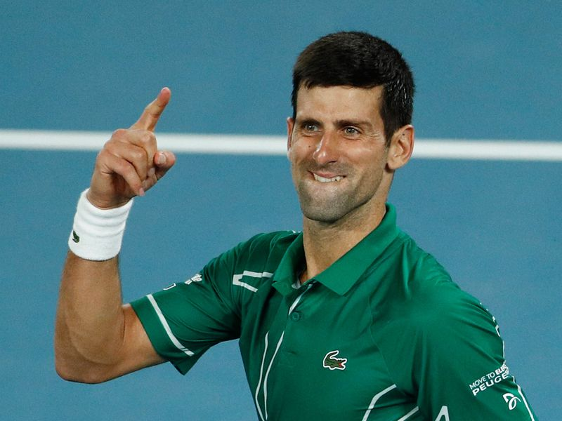 Serbia's Novak Djokovic celebrates after his match against Switzerland's Roger Federer