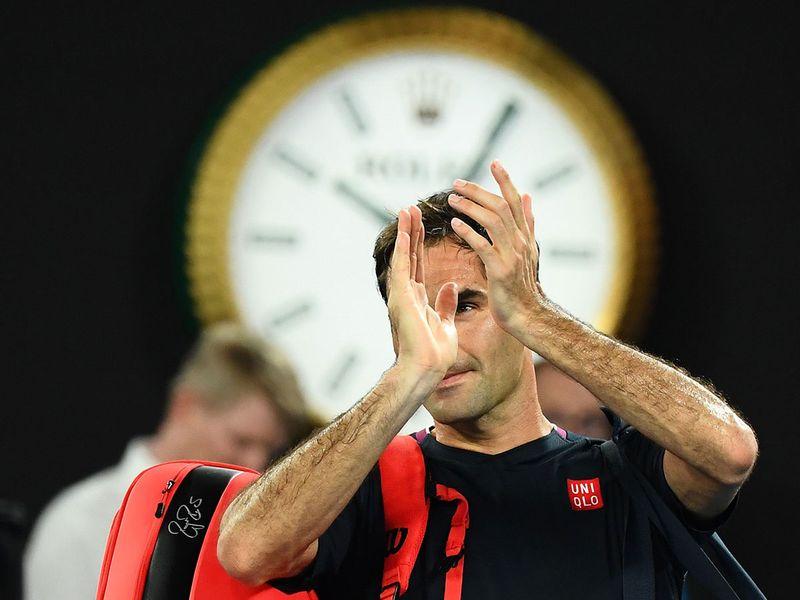 Switzerland's Roger Federer applauds after losing to Serbia's Novak Djokovic