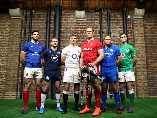 Team captains pose for a photo with the Six Nations Trophy, left to right, France's Charles Ollivon, Scotland's Stuart Hogg, England's Owen Farrell, Wales' Alun Wyn Jones, Italy's Luca Bigi and Ireland's Jonathan Sexton during the Six Nations launch.