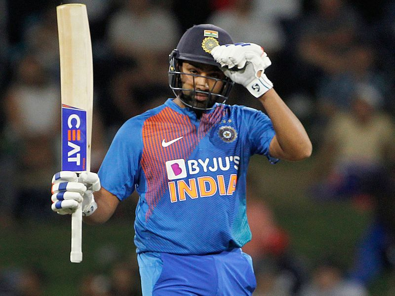 India's Rohit Sharma celebrates his half-century
