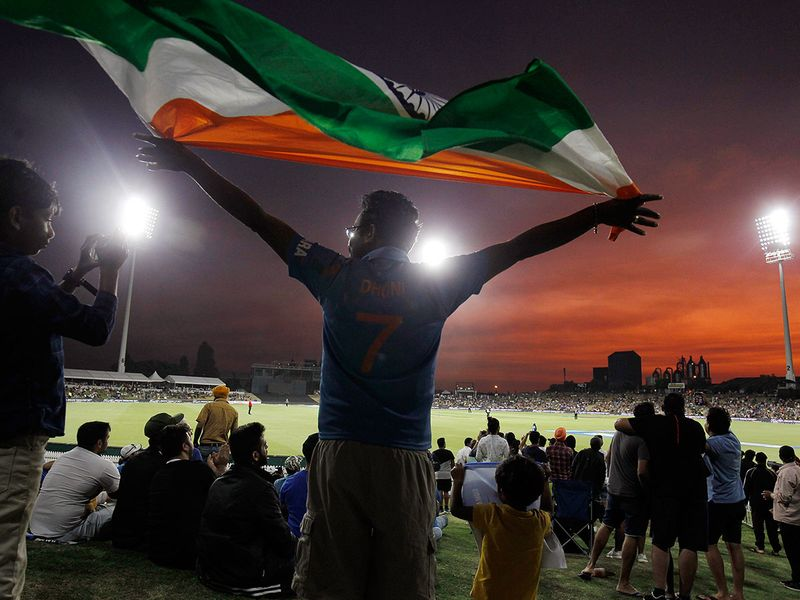 An Indian fan cheers in New Zealand