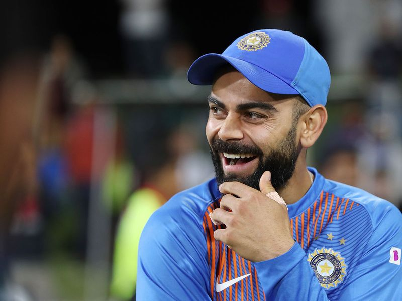 Indian captain Virat Kohli celebrates after winning the fifth Twenty20 cricket match between New Zealand and India at the Bay Oval in Mount Maunganu