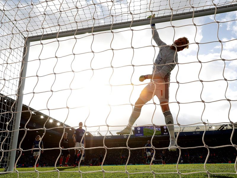 Leicester City's Danish goalkeeper Kasper Schmeichel tips the ball over the bar during the English Premier League football match against Chelsea