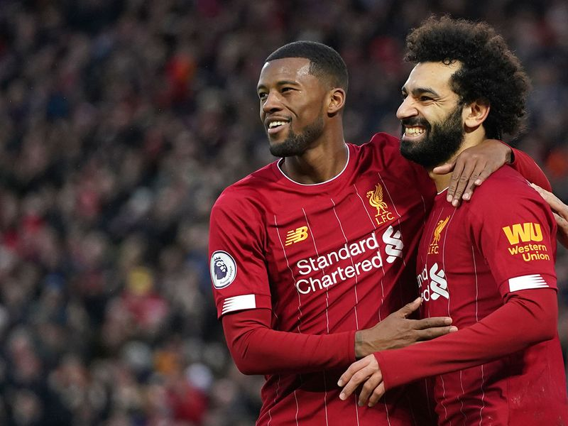 Liverpool's Mohamed Salah, right, celebrates with Georginio Wijnaldum after scoring his sides third goal.ier League soccer match between Liverpool and Southampton at Anfield Stadium