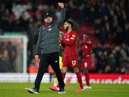 Liverpool's manager Jurgen Klopp greets supporters after the 4-0 win over Southampton