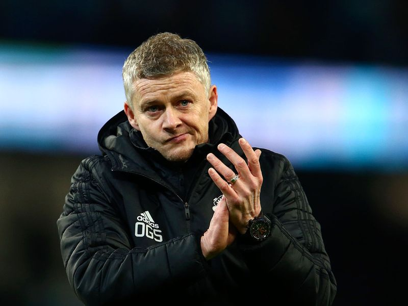 Manchester United's manager Ole Gunnar Solskjaer applauds the supporters