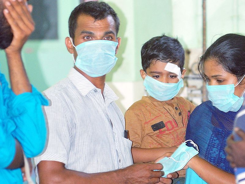 OPD patients and staff members wear safety masks as a precaution after the outbreak of coronavirus, at a hospital in Thrissur, Kerala.
