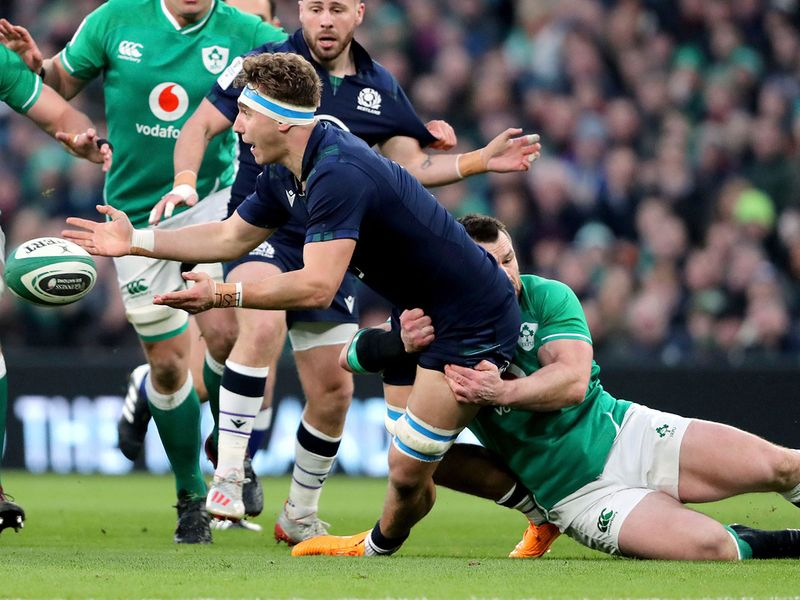 Scotland's Jamie Ritchie, left, is tackled by Ireland's Cian Healy