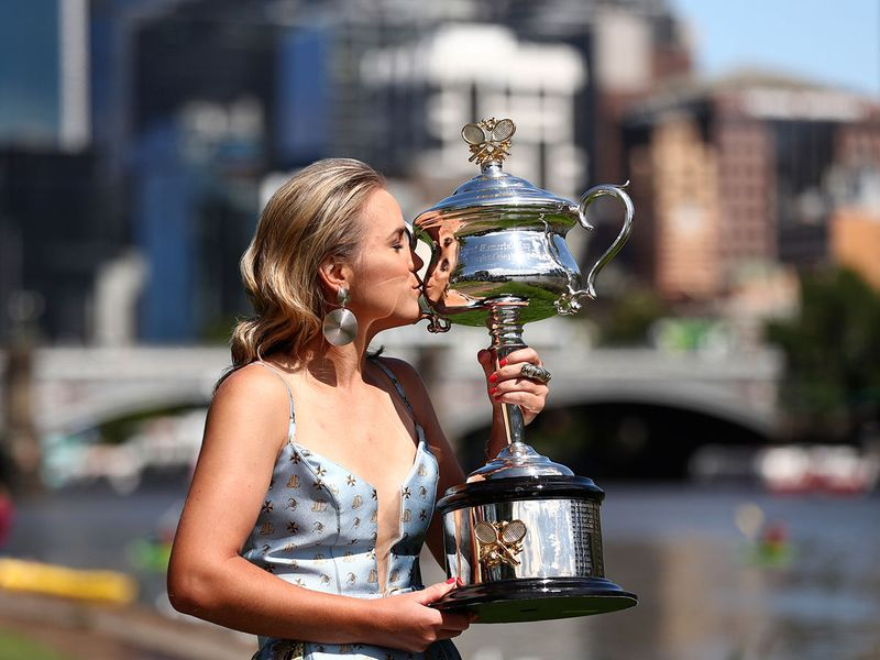 Sofia Kenin with the Daphne Ackhurst Memorial Cup following her win over Spain's Garbine Muguruza in women's singles final of the Australian Open tennis championship