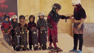 TAB Learning to Skateboard in a Warzone-1580621006449