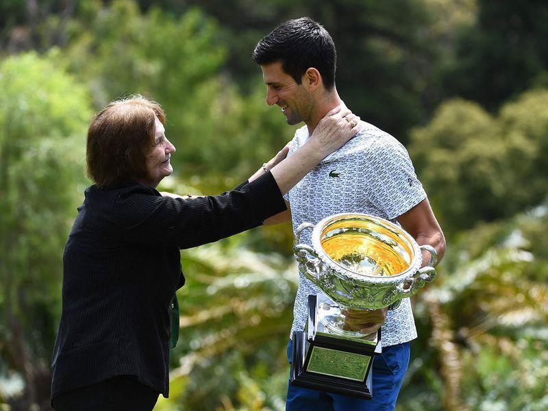 A fan gives Serbia's Novak Djokovic a hug