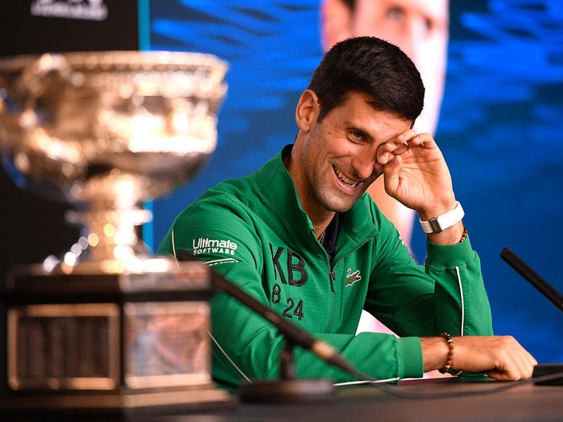 Djokovic shares a laugh with the media